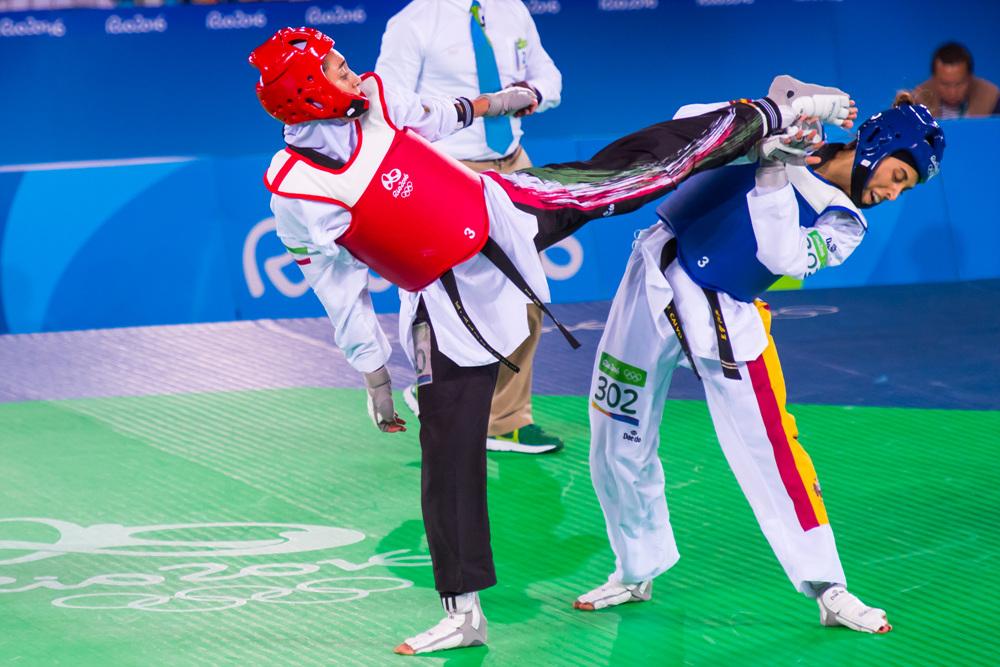 Kimia Alizadeh Zenoorin (left) vs. Eva Calvo Gomez (right) during their match in 2016 Rio Olympics.