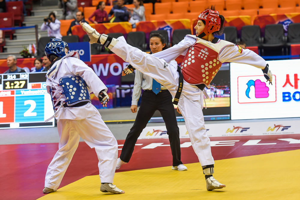 Eva Calvo Gomez (right) competes during the 2015 World Taekwondo Championships in Chelyabinsk, Russia.