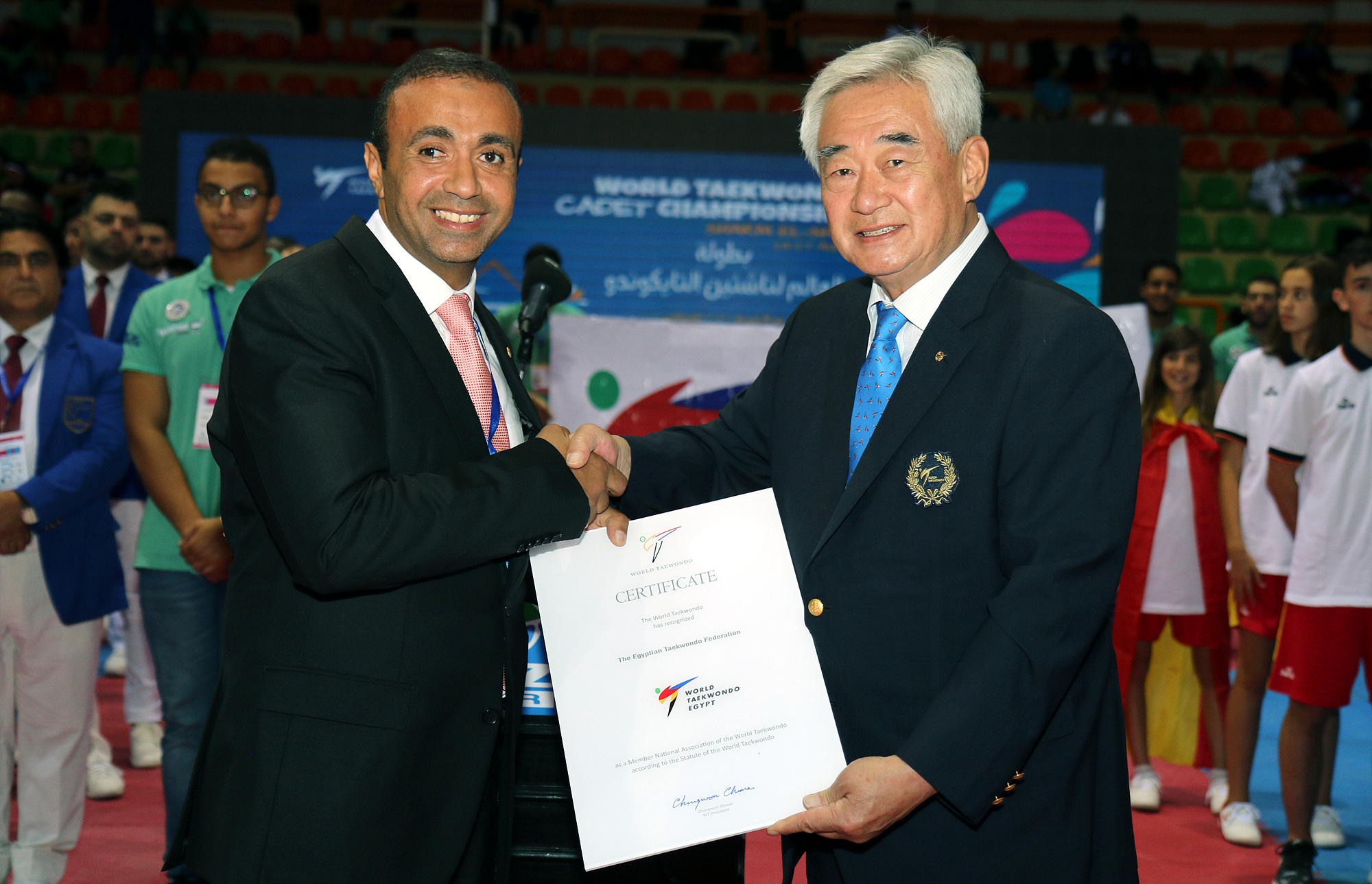 WT President Choue gives a certificate to ETF President Dr. Mohammed Ali
