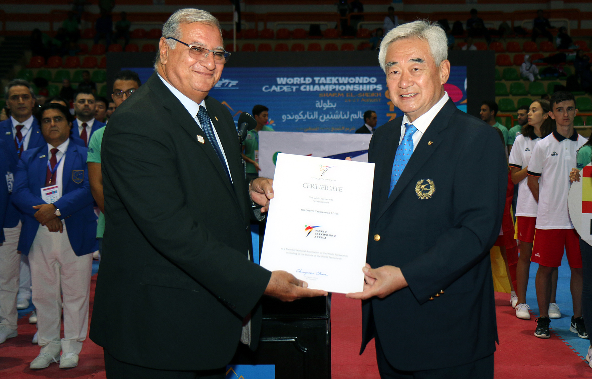 WT President Choue gives a certificate to WTAF President Gen. Ahmed Fouly