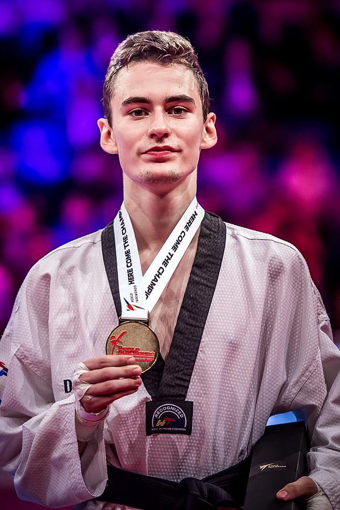 Mikhail Artamonov (RUS) - the gold medalist of M-58kg