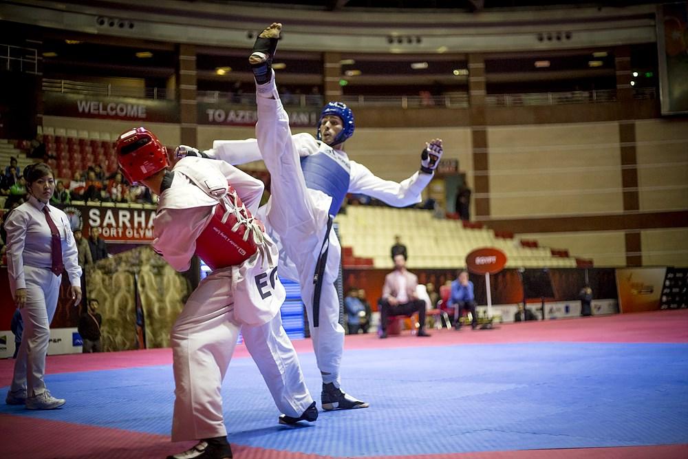 Azerbaijan's Milad Beigi Harchegani drops an ax kick onto Egypt's Seif Eissa.