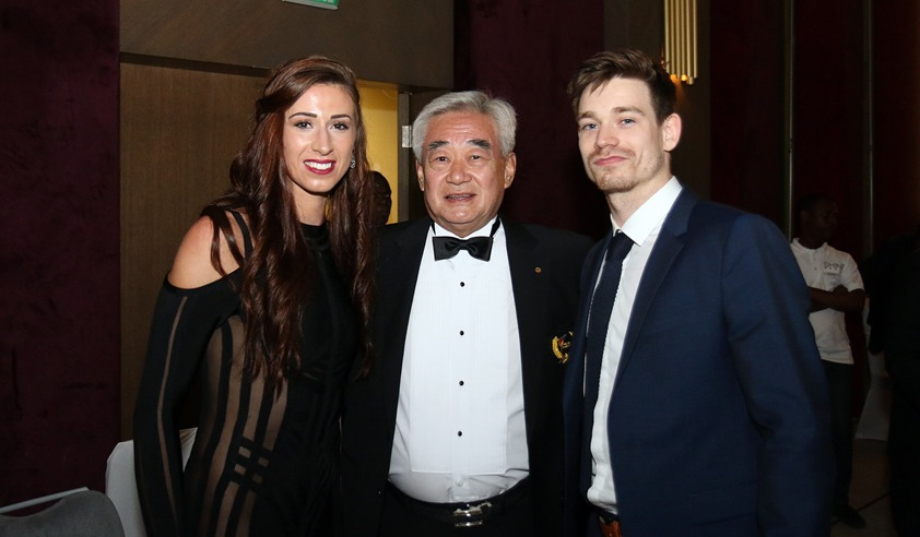 Biancan Walkden and Aaron Cook with WT President Chungwon Choue (center) during the Gala Awards