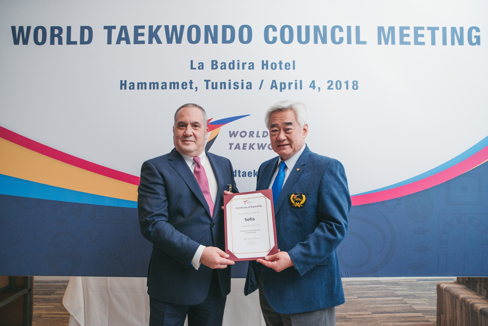 WT President Chungwon Choue awards certificate to Sofia being selected as the host city for 2020 World Taekwondo Junior Championships