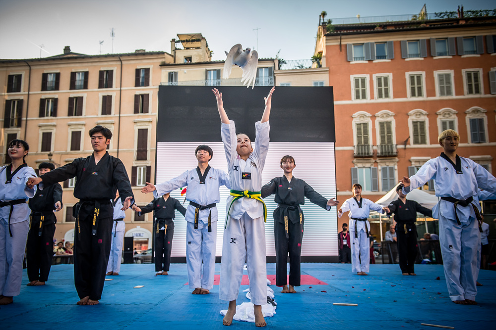 Beatrice Oliveri sends out dove during the WT demonstration team's performance held at the Spanish Steps in Rome