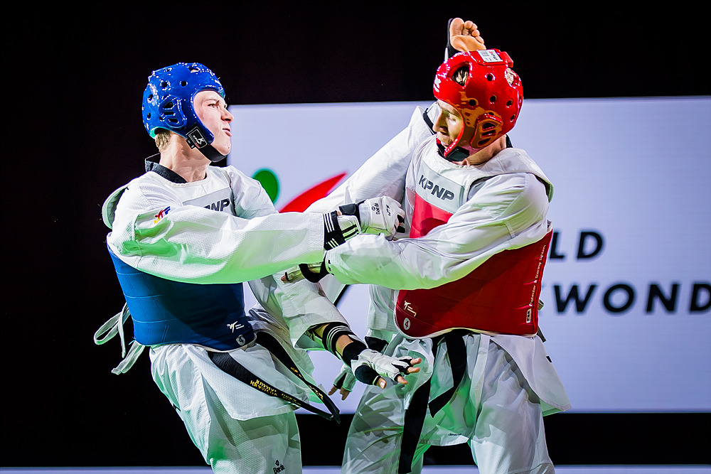 Maksim KHRAMTCOV (left) is attaking to opponent at the final match