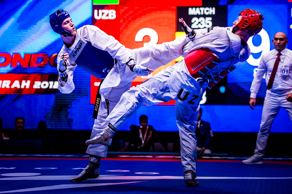 Maksim Khramtcov (left) is attacking oopponent at the Semi Final of -80kg