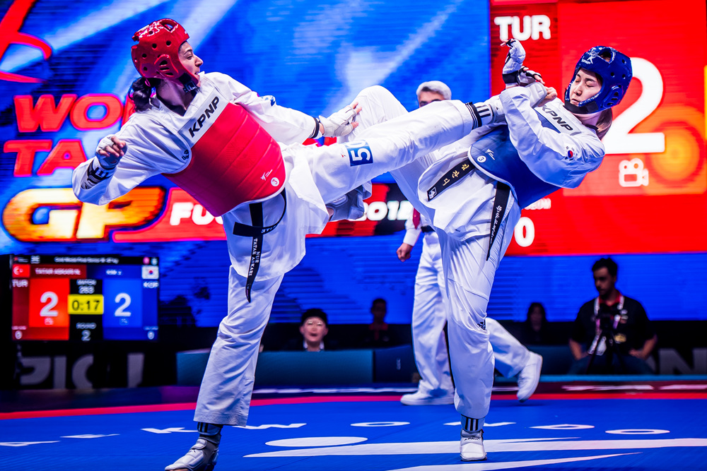 Nur Tatar Askari (TUR) is attacking opponent at the final of -67kg