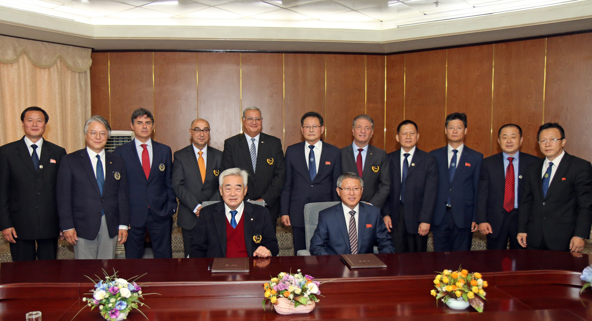 WT and ITF officials poses after the signing ceremony of WT-ITF agreement at Pyongyang Yanggakdo Internationl Hotel on Nov. 2 2018