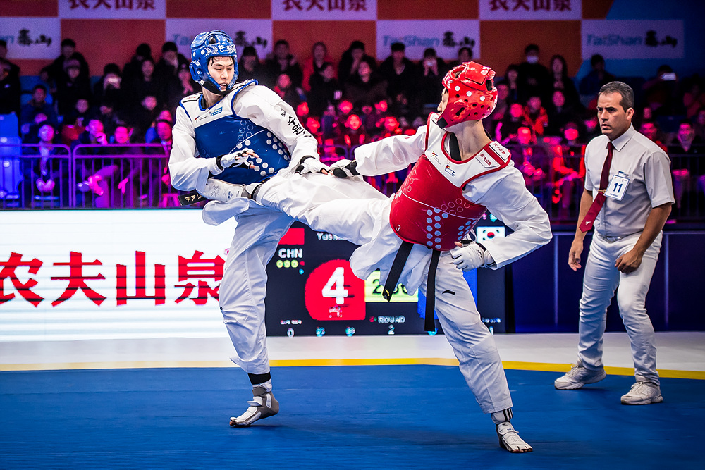 Yushuai LIANG (CHN, right) is attacking opponent at the semi-final match of M -58kg