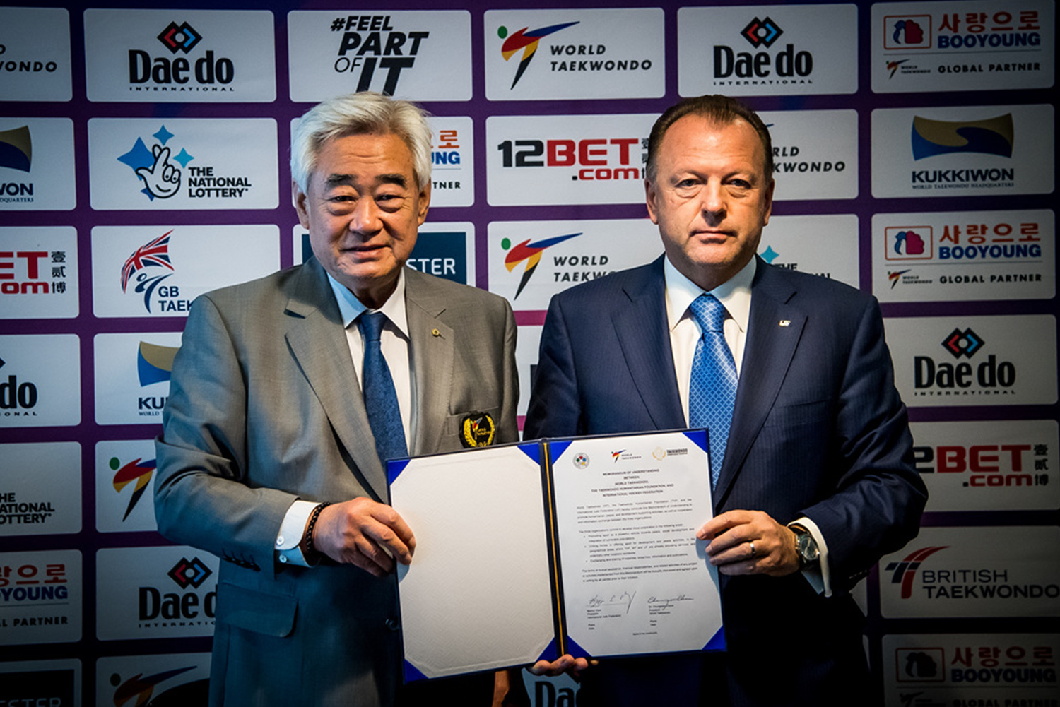 WT President Chungwon Choue (left) and IJF President Marius Vizer during the MOU ceremony