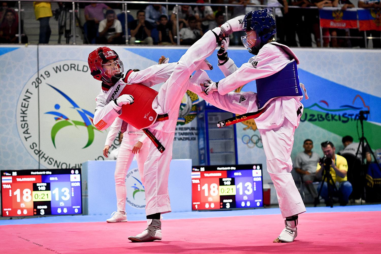 TALATNGOEN Waranya (THA, left) attacks opponent at the final of W-29kg