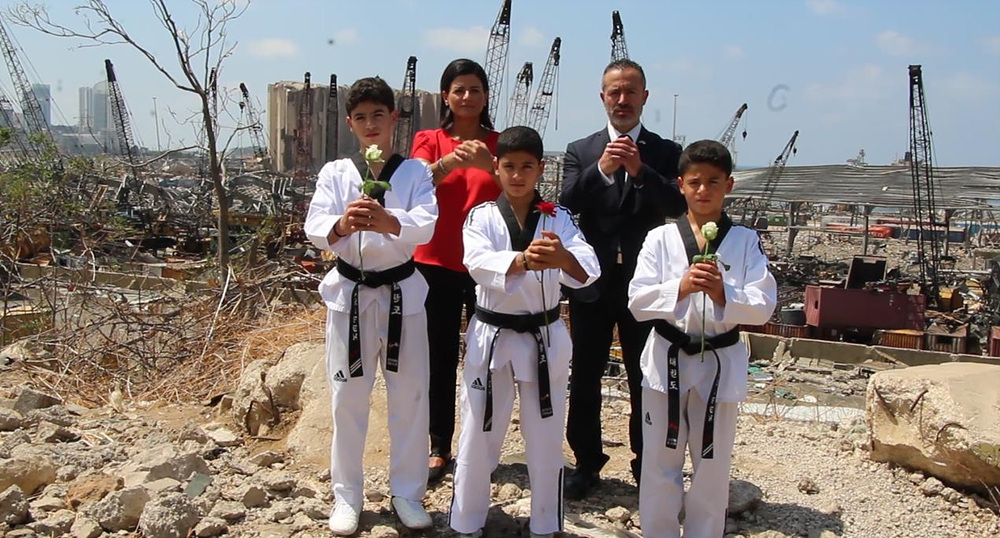 LTF President (right at the back) with taekwondo practitioners at the explosion site